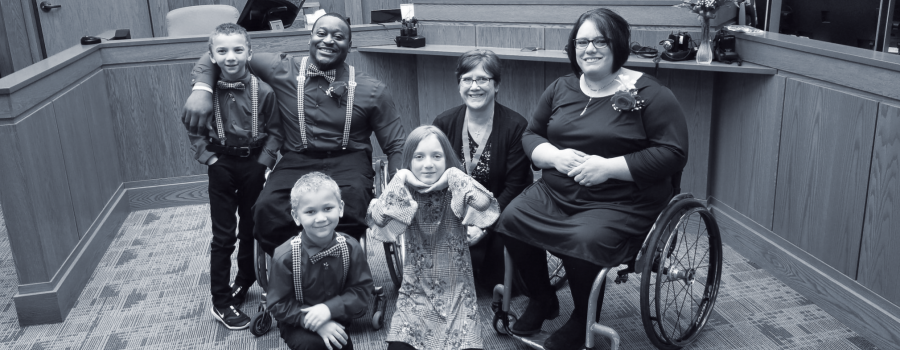 Anna and Master Kinkle at the adoption ceremony with their three kids